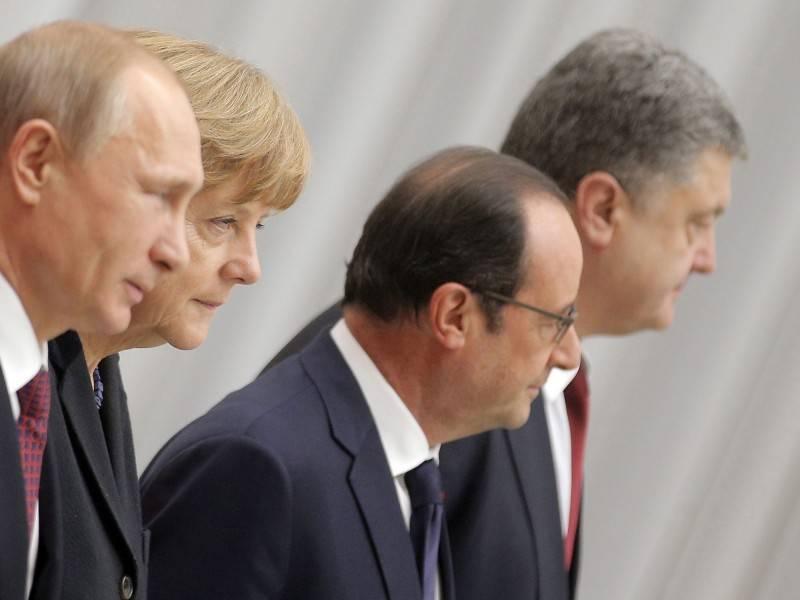Putin, Merkel, Hollande, Poroschenko-Nach 17 Stunden zu einem Ergebnis gekommen in Minsk. (picture alliance-dpa-Maxim Shipenkov)